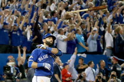 Jose Bautista and the bat flip that put the Blue Jays in the ALCS. (Photo by Tom Szczerbowski/Getty Images)